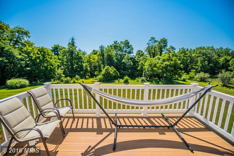 Picture of rear deck view of the property at 187 Revolutionary Road in Charles Town, West Virginia, a real estate listing presented by Adam Miller, REALTOR